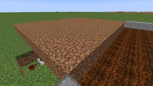 回路にかぶさるように設置された土ブロック