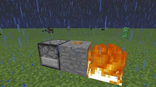 石の前で燃える炎